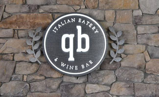 Quanto Basta Logo and Sign