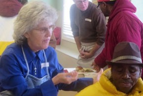 Woman feeding homeless person: Food, Soup Kitchens & Pantries in Winston-Salem